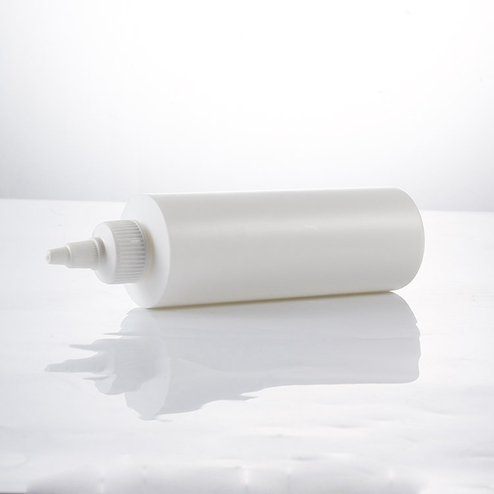 white cylinder round bottle with twist cap