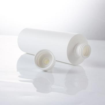 white cylinder round bottle