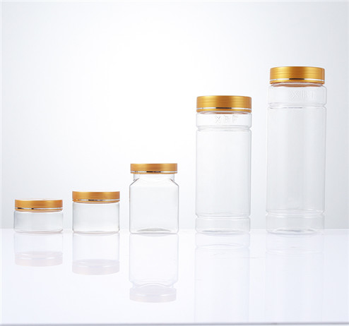 different clear storage plastic jars with yellow cap