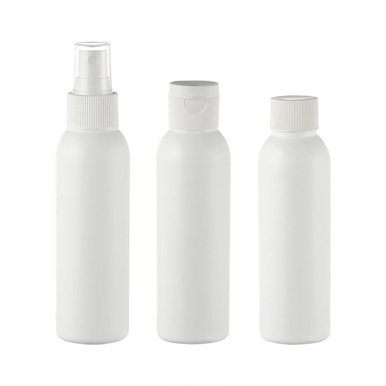white cosmo shape plastic bottle with flip cap mist sprayer